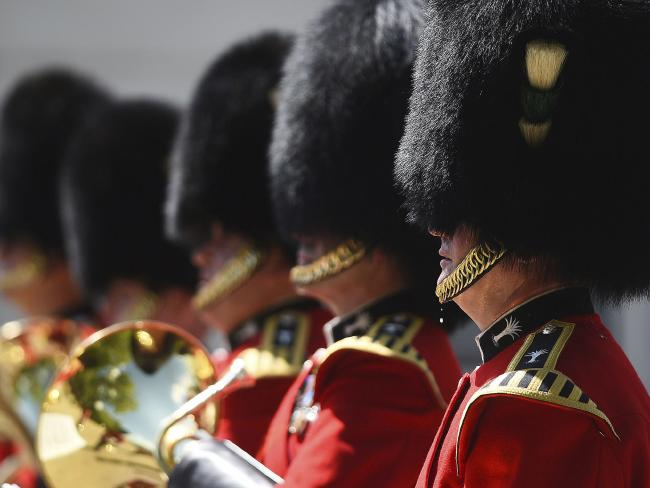 A bead of sweat falls from a member of The Queen's Guard as he takes part in the Changing the Guard ceremony at Wellington Barracks, in London. Picture: AP
