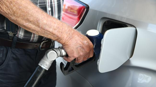 A motorist fills his car up with fuel from the petrol bowser. Picture: Brendan Radke.
