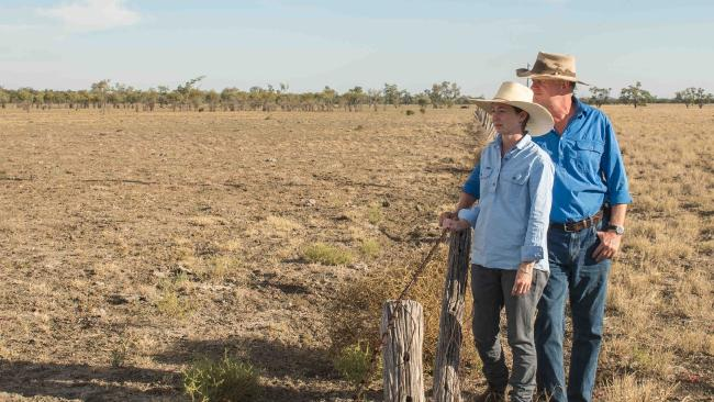 Two farmers survey the drought's impact on their property near Augathella in western Queensland.  Picture: Katrina Lehmann