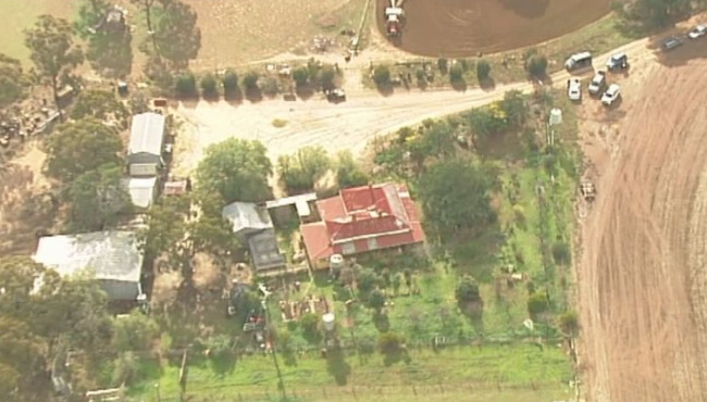 Several police vehicles are at the rural property. Picture: 9 News