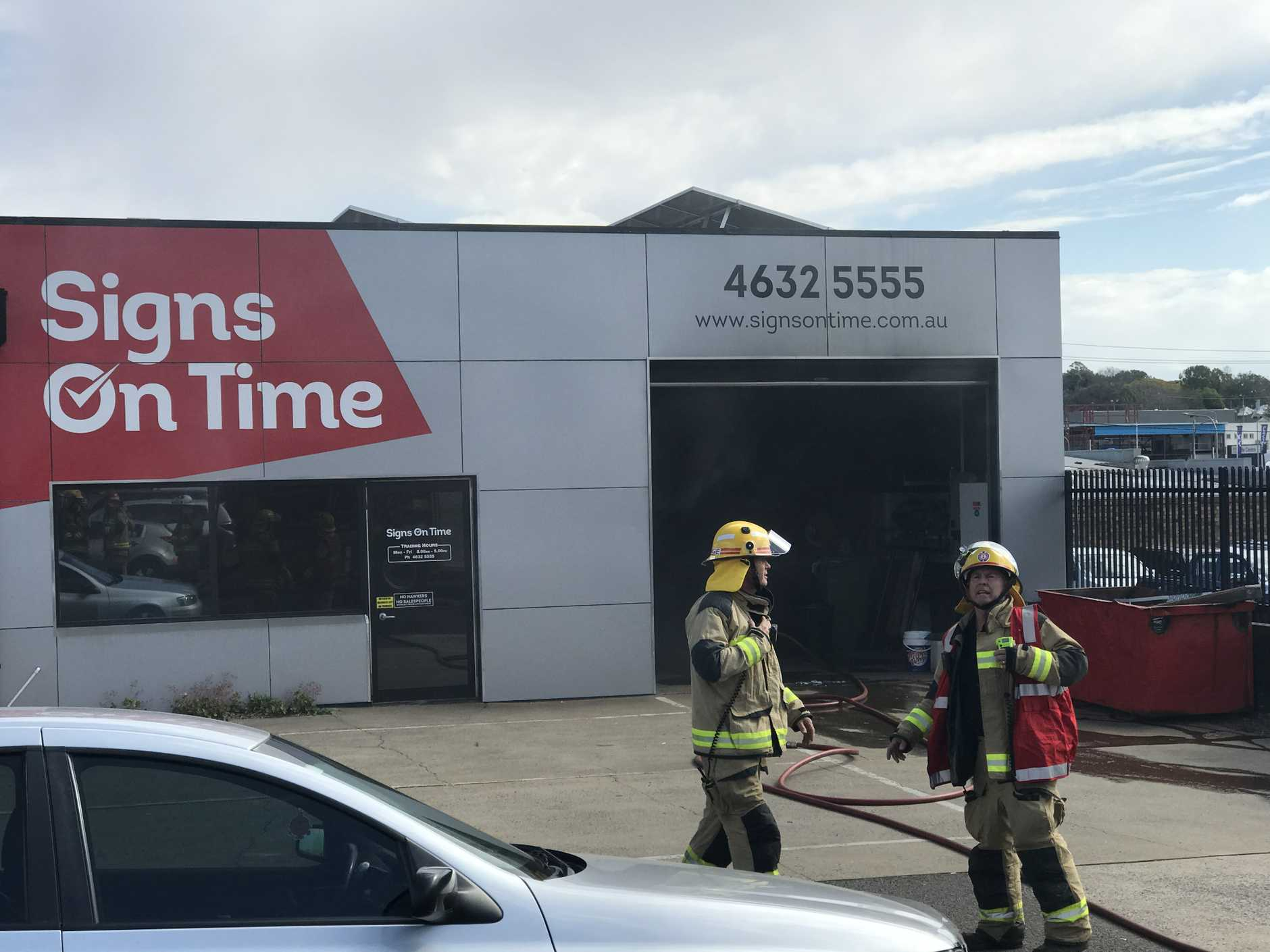 Emergency services at Signs on Time on Wylie St after a fire broke out in a laser cutting room.