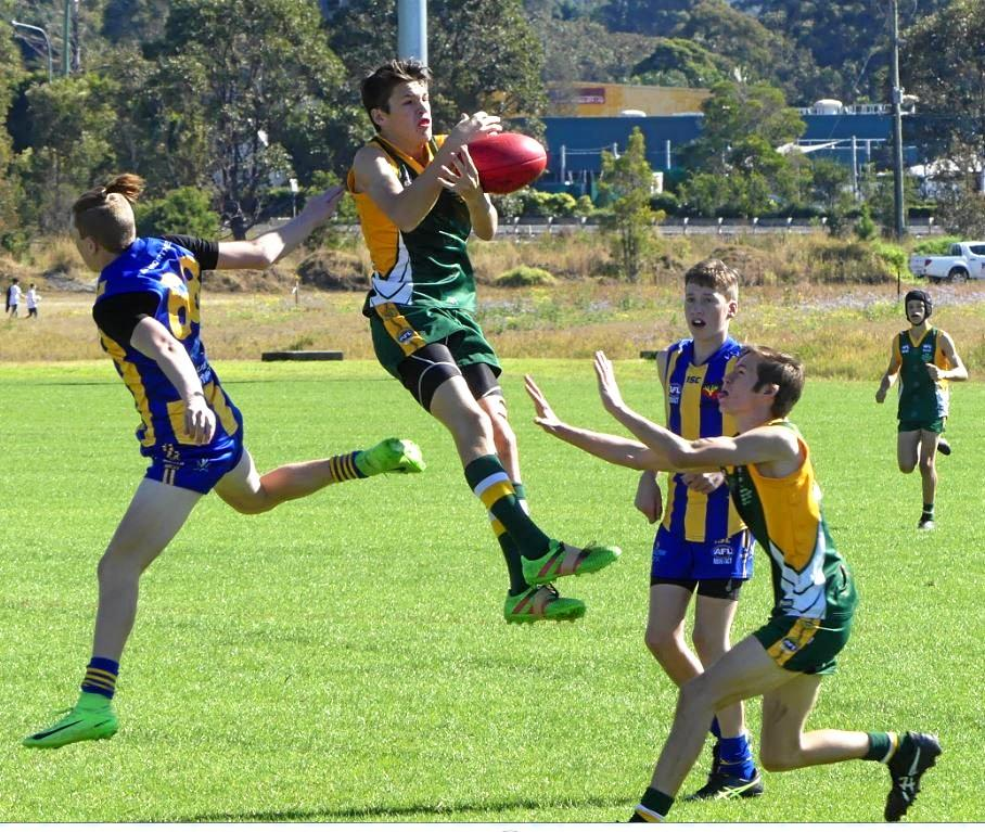 SKY HIGH: Reuben George (centre) named best and fairest for Northern Force in under-15's.