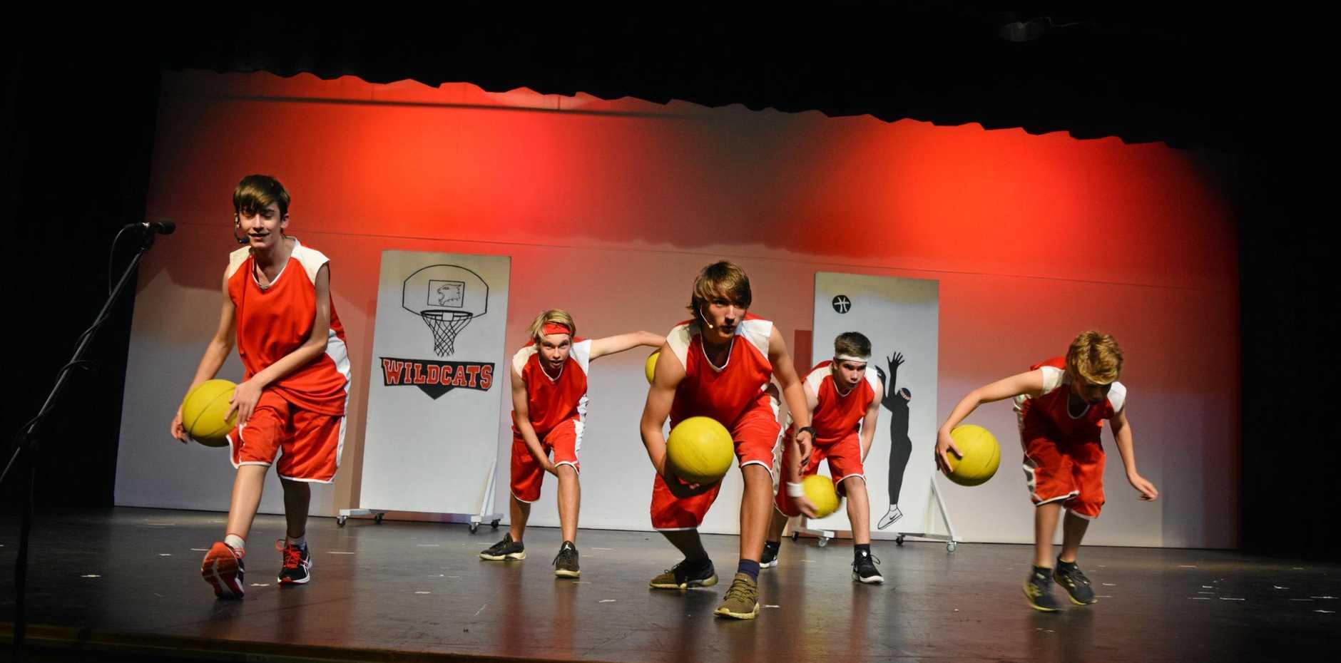 Biloela State High School students Loukas Vasiliadis, Noah Bongers, Stuart Arnold, Michael Steger and Riley Arnold on stage as the basketballers.