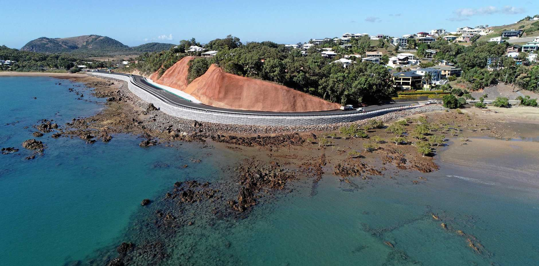 AT LAST: The final line markings are put on the Scenic Highway at Statue Bay yesterday afternoon prior to the road being reopened today.