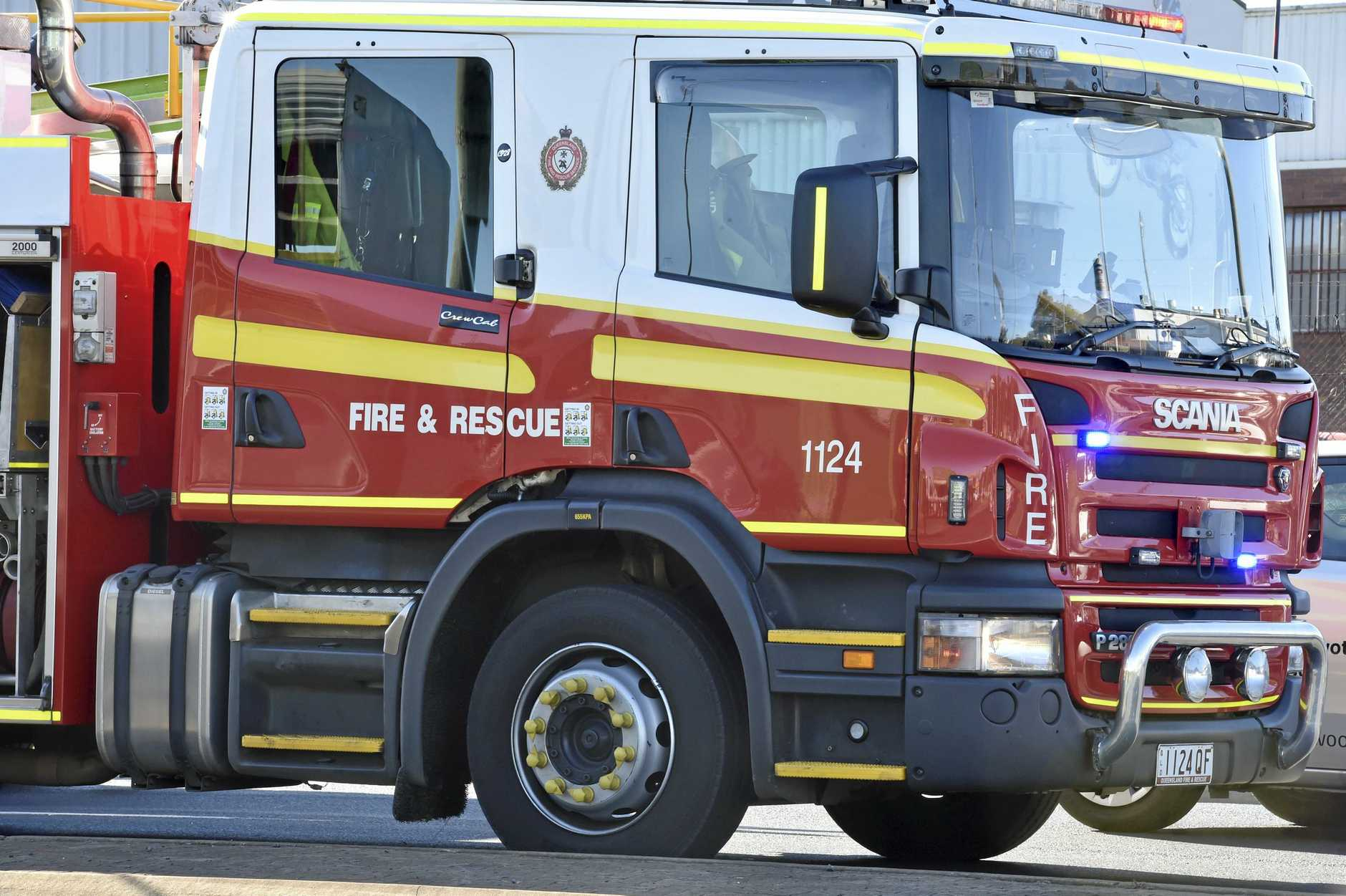 Firefighters were called to an industrial shed that was alight with smoke billowing from the building early Tuesday morning.