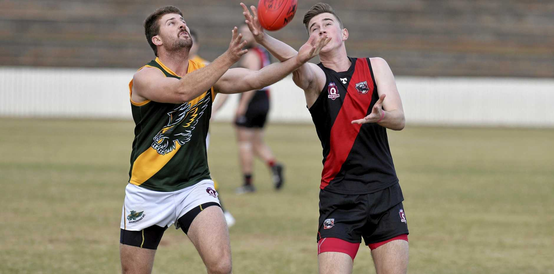 HOT CONTEST: Angus Croft (left) of the Goondiwindi Hawks and Tyler Gilmore of the South Toowoomba Bombers fight for possession during an earlier fixture this season.
