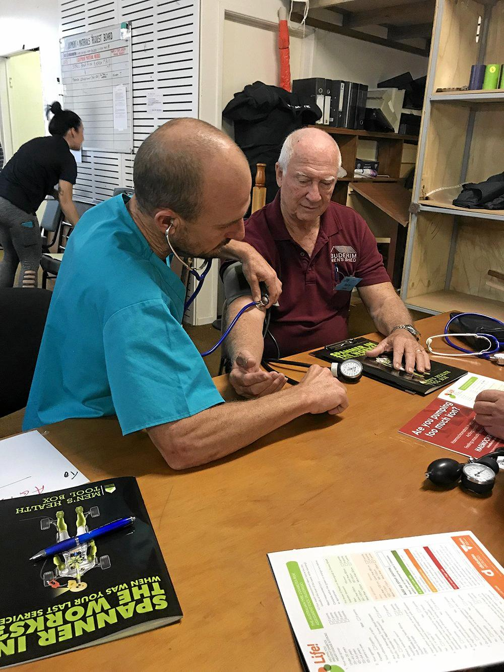 University of the Sunshine Coast students conduct health checks at the Buderim Men's Shed.