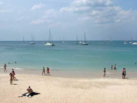 Tourist resort. Sandy Nai Harn beach with people.