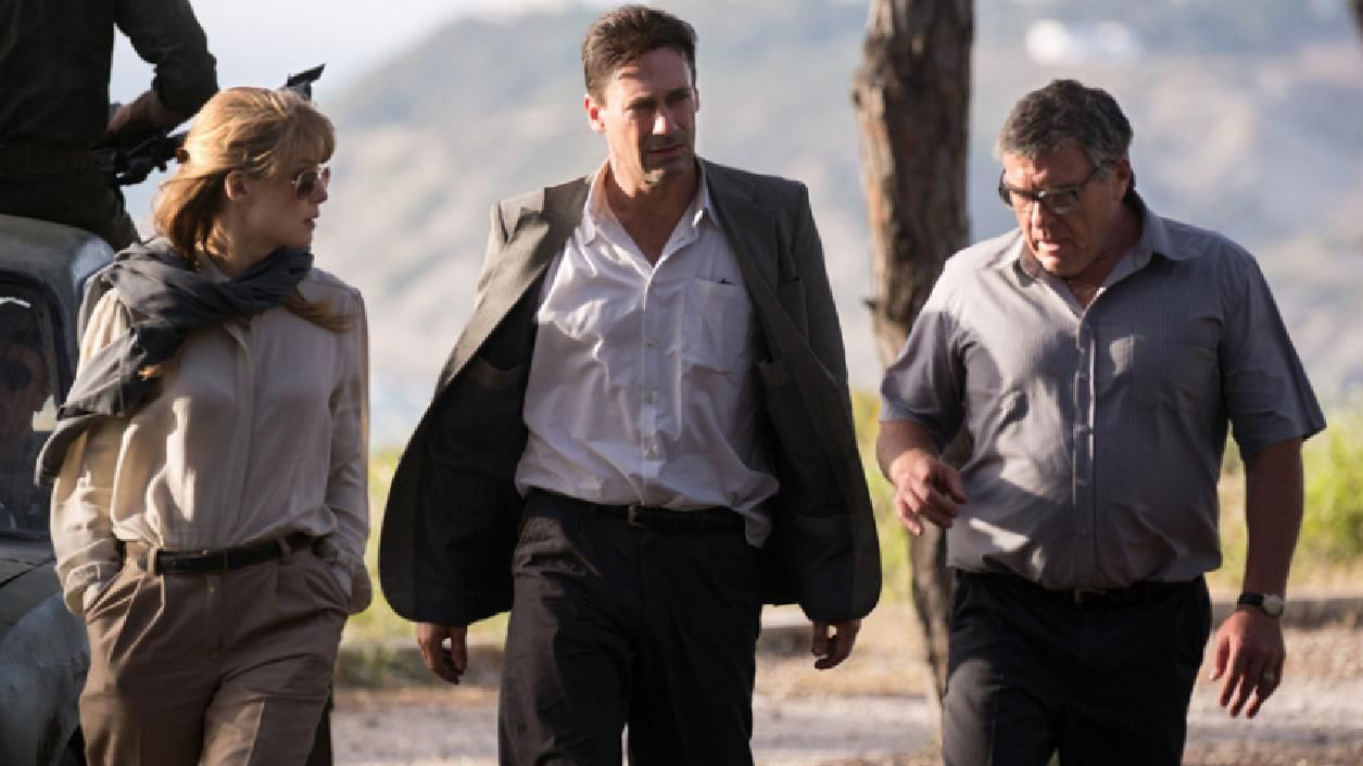 Jon Hamm, Rosamund Pike and Dean Norris in a scene from Beirut.