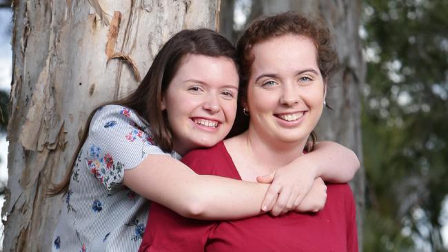 Abby Ward and best friend Maddie Bateman-Duffy ahead of their school formal. Picture:  AAP/Steve Pohlner