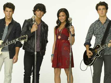 Nick Jonas, Joe Jonas, Demi Lovato and Kevin Jonas in Disney's Camp Rock. Picture: Supplied