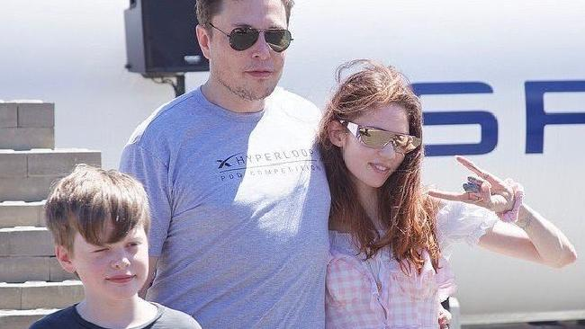 Elon Musk with his girlfriend Grimes and his son.