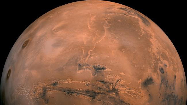 This composite photo was created from more than 100 images of Mars taken by Viking Orbiters in the 1970s. Picture: NASA