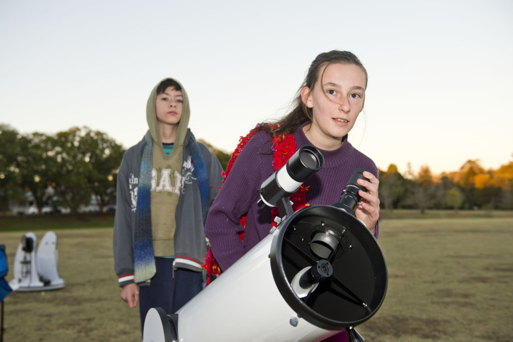 Thomas Picton and Larissa Picton search the night sky.