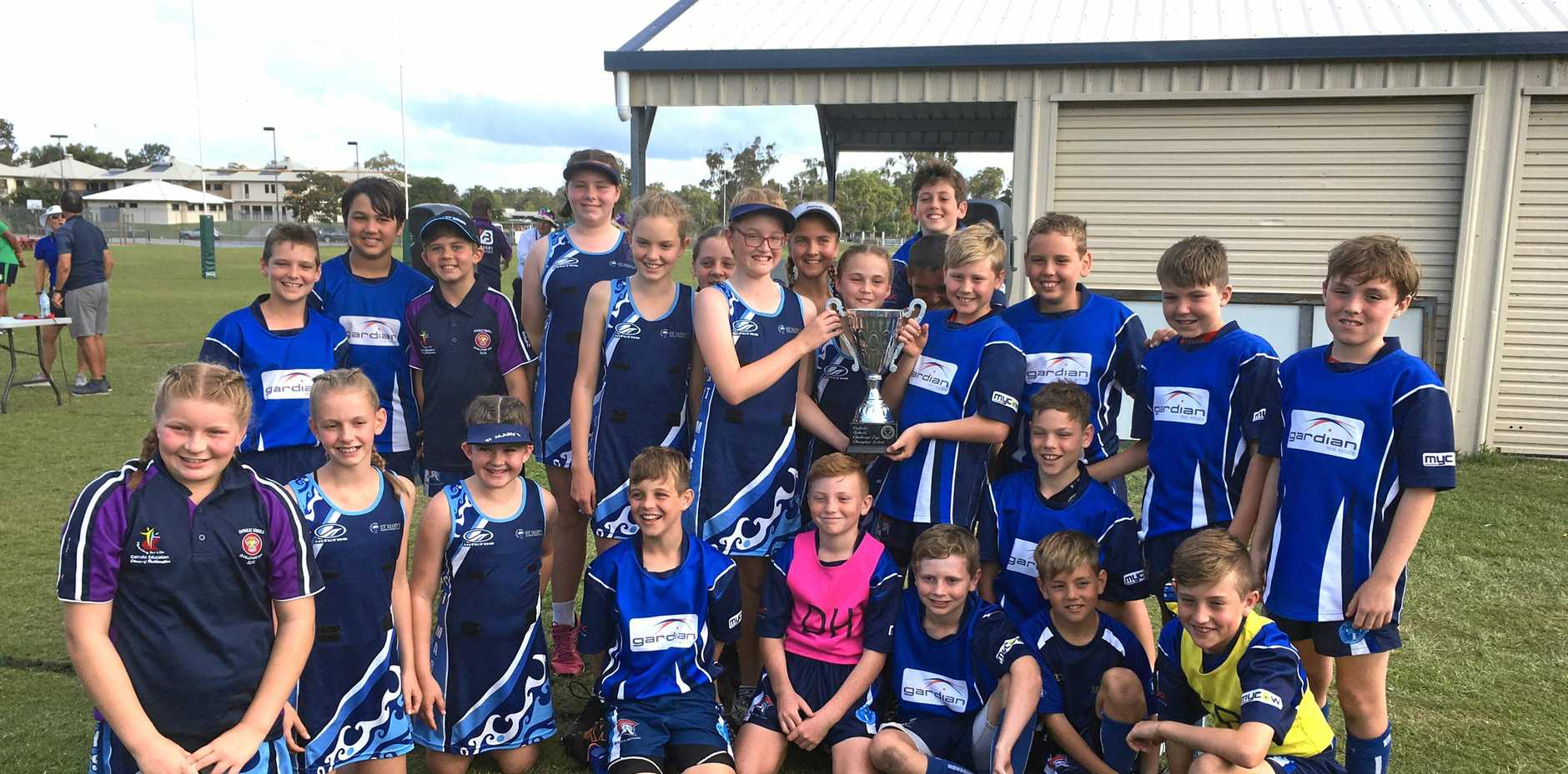 St Mary's Catholic Primary School students celebrate with the Overall Challenge Cup at the Catholic Schools' Challenge Cup in Yeppoon.