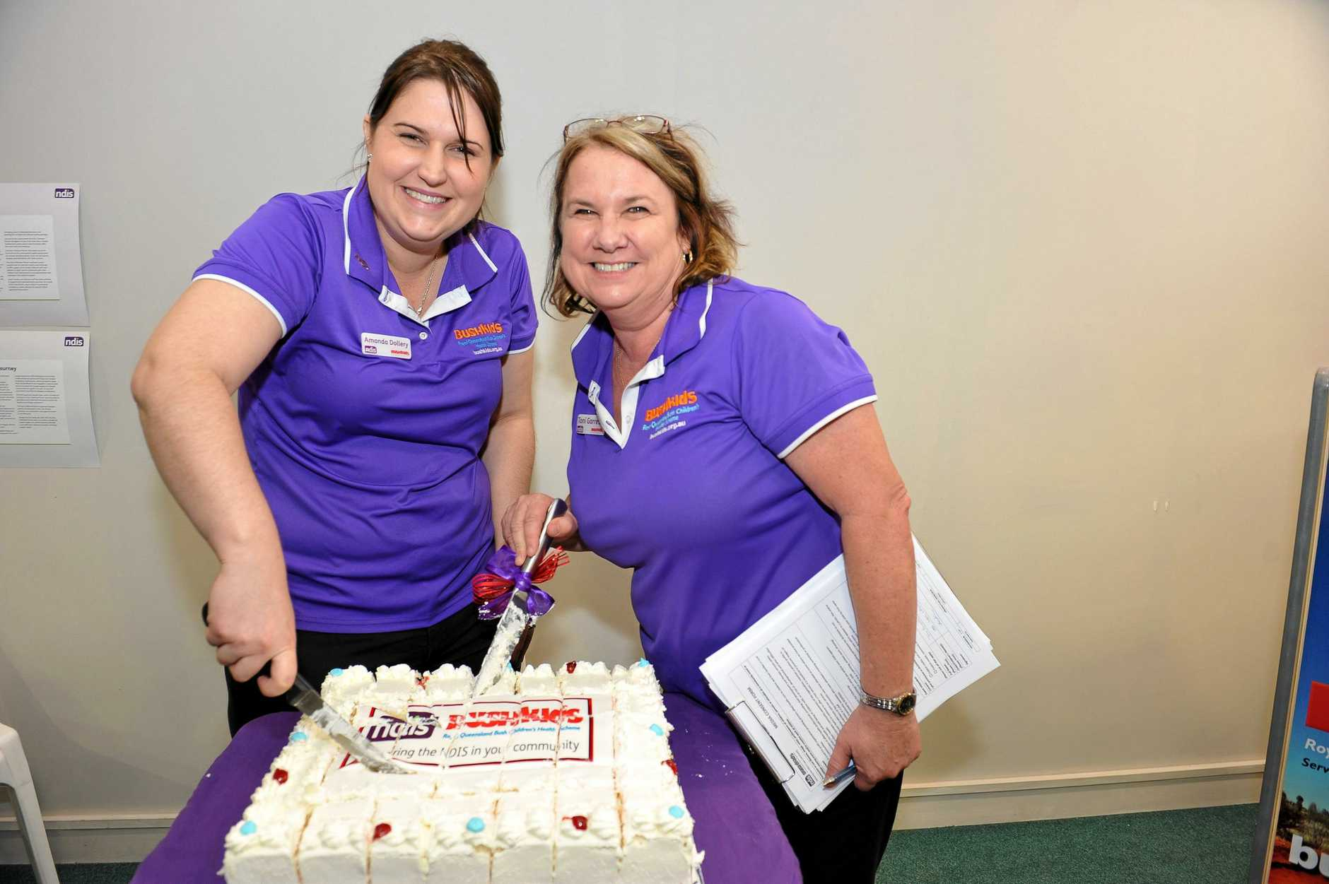 Amanda Dollery and Toni Garrett cut the cake for the opening of BUSHkids Early Childhood Early Intervention service centre in Gladstone.