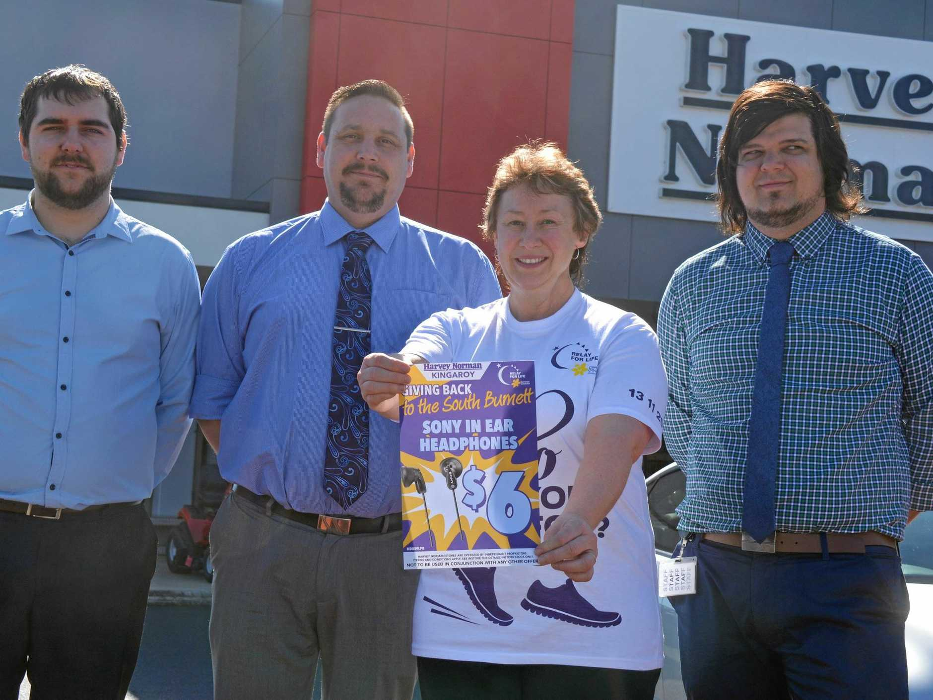 COMMUNITY SUPPORT: Ryan Maxwell, Shaun Treacy, Rowena Dionysus and Brendan Young get prepared for Harvey Norman Kingaroy's Giving Back to the South Burnett sale.