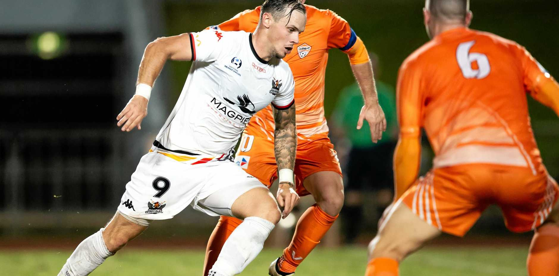 Magpies Crusaders captain Michael Lyall on the move against Cairns FC.