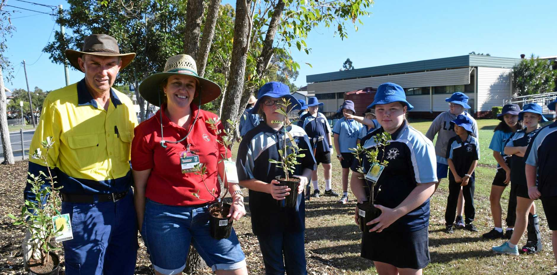Sunbury School facility officer Bryson Jones, Bunnings activities co-ordinator, student leaders Ellie McLeod and Kiara Bettles with a selection of native plants for School's Tree Day.
