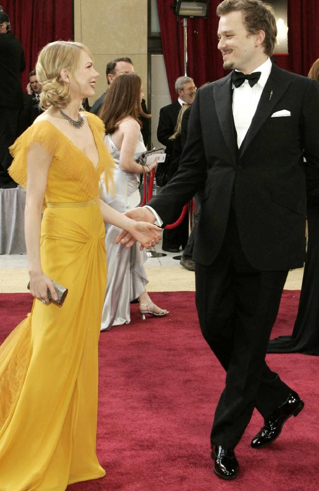 Michelle Williams (L) dances on the red carpet with her fiance Heath Ledger in 2006. Picture: Supplied