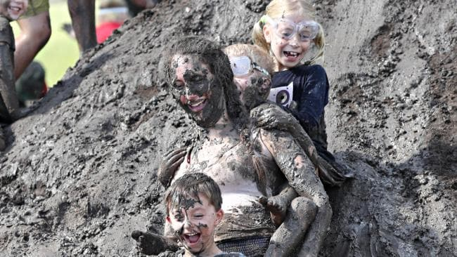 Paloma Hope with Remy, 5, and Dom and Bella, 7 at Mud World in Ipswich. Luckily kids (and adults) are easy-clean. (Pic: Annette Dew)