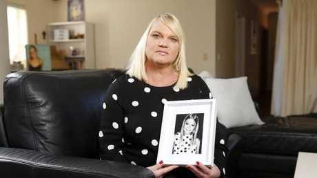 Kirsten McGinty holds a photo of Zoeat her home in Clayfield. Picture: AAP Image/Josh Woning