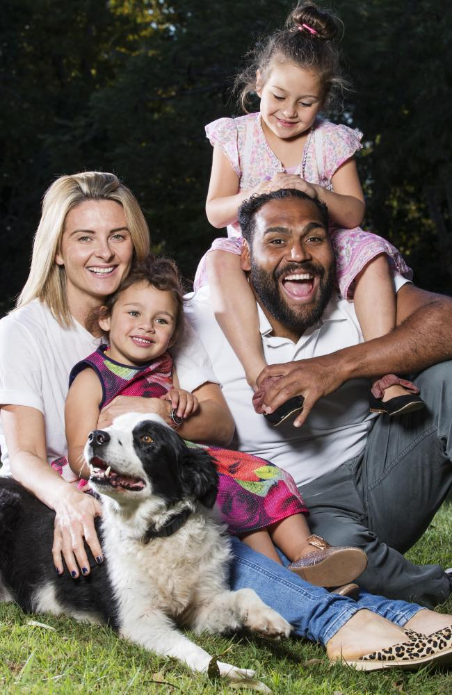 Sam and Rachel Thaiday relax at home with daughters Ellsie, 3, and Gracie, 5. Picture: Lachie Millard