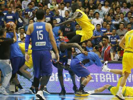 Australia's Thon Maker launches a fly kick at a Philippines rival. Picture: Bullit Marquez