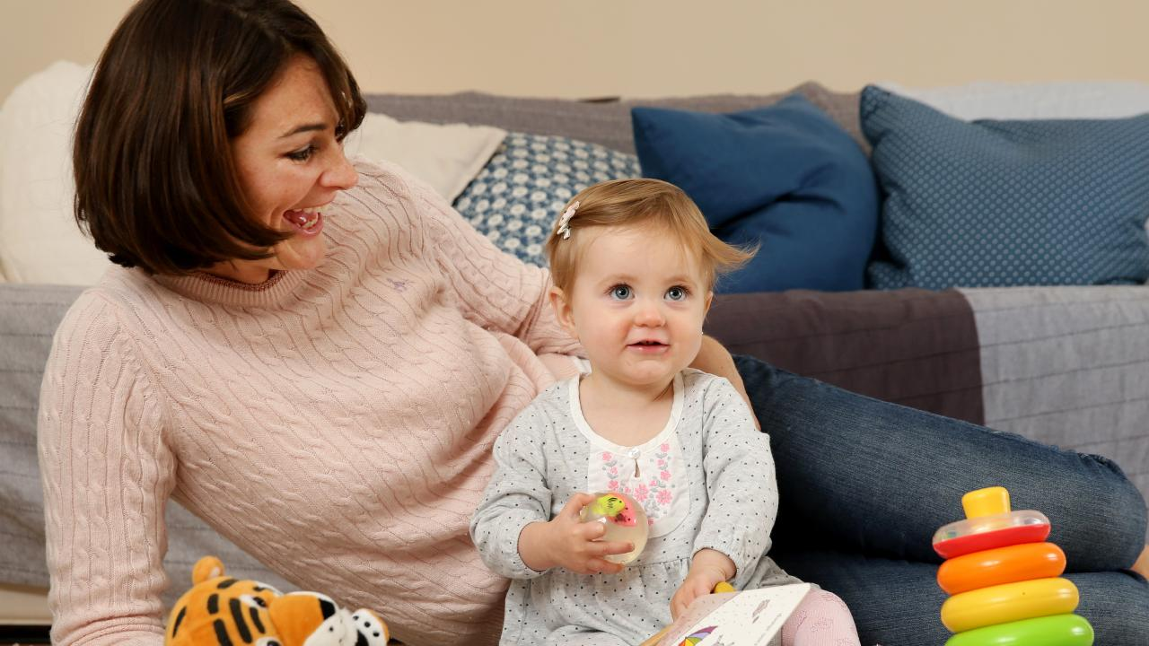 Alex Martin plays with one-year-old daughter, Holly, at their Bondi home. She has been overwhelmed with support by admits single parenthood can sometimes be a lonely path and not without struggles. Picture: Jonathan Ng