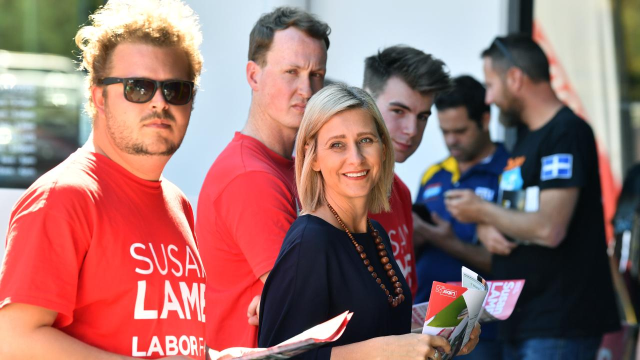 Labor's candidate for Longman Susan Lamb (centre) is seen at a pre-polling station in Morayfield. Picture: AAP/Darren England