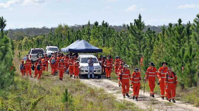 Inspector Brett long and SES volunteers sweep the Toolara State Forest near Tin Can Bay. Picture: Patrick Woods / The Gympie Times