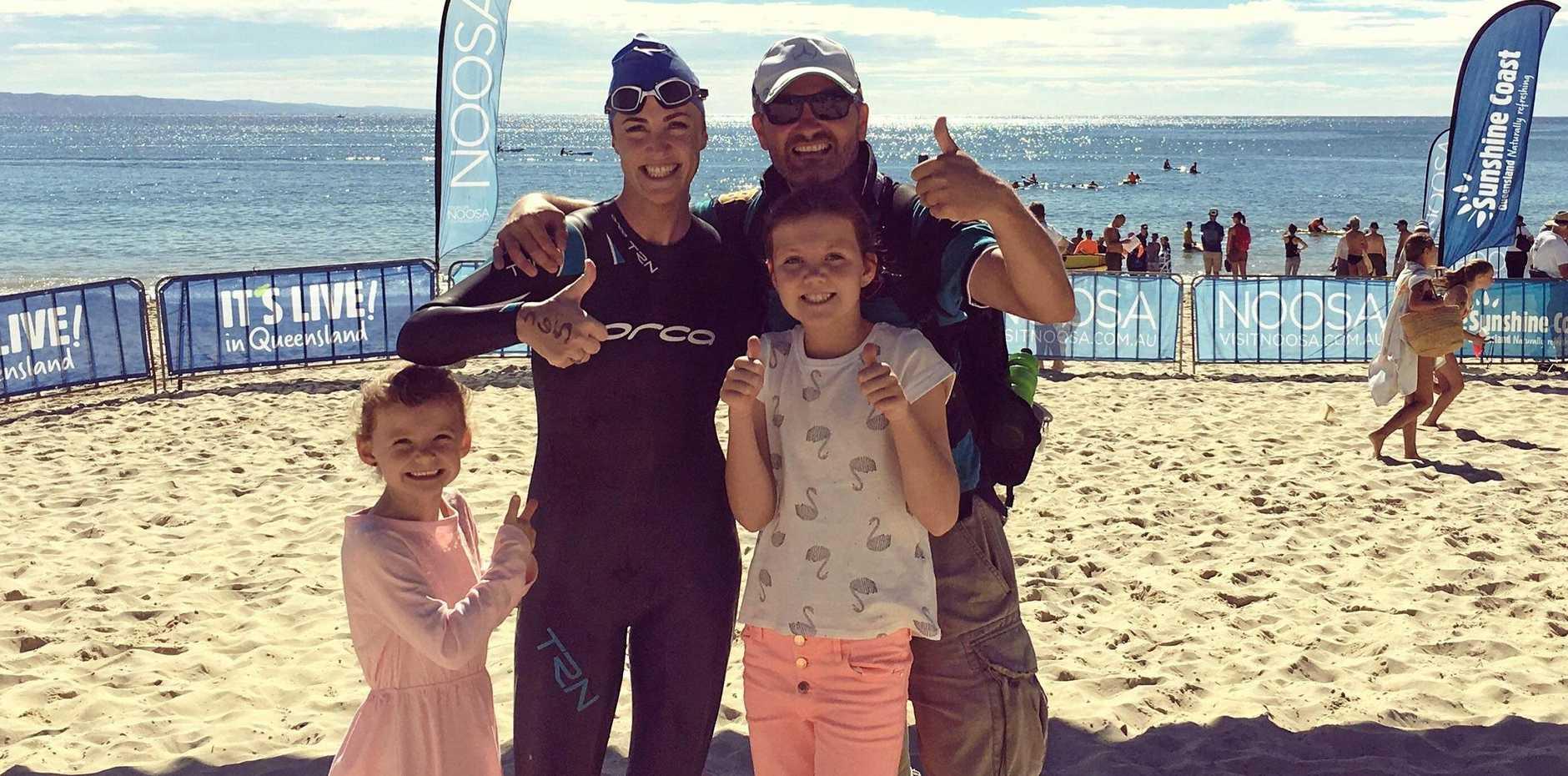 BIG BREAKTHROUGH: Yeppoon's Mara O'Reilly with husband Sheamus and daughters Cliodhna and Neassa after she conquered her first 500m ocean swim at Noosa.