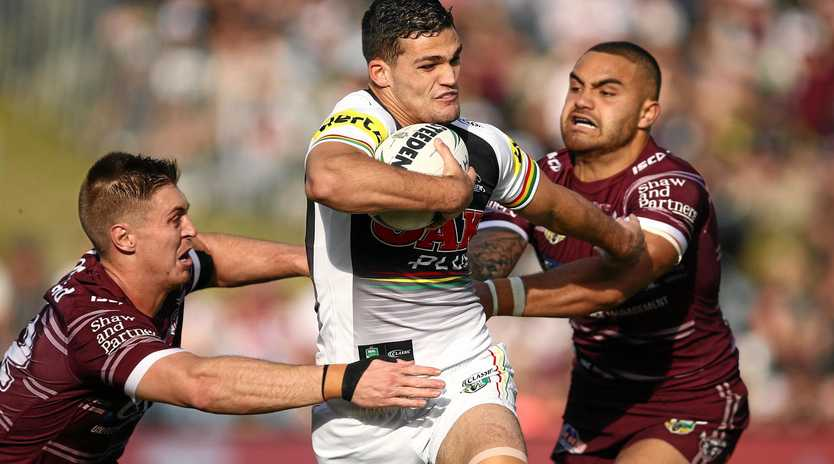 The Panthers' Nathan Cleary is tackled by Shaun Lane and Dylan Walker of the Sea Eagles during their round 20 clash on Saturday afternoon. Picture: Brendon Thorne/AAP