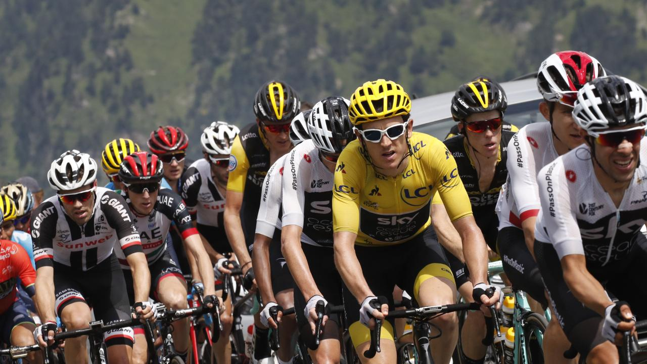 Spain's Jonathan Castroviejo, far right, sets the pace for Geraint Thomas, wearing the overall leader's yellow jersey, as he climbs Col du Tourmalet pass with Slovenia's Primoz Roglic, third from right. Picture: Christophe Ena/AP