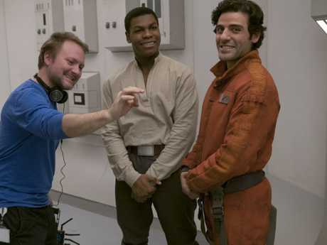 L to R: Director Rian Johnson with actors John Boyega (plays Finn) and Oscar Isaac (Poe Dameron). Picture: David James ©2017 Lucasfilm Ltd.