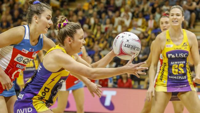The Lightning's Kelsey Browne (second from left) gets possession of the ball as the Swifts close in. Picture: Glenn Hunt/AAP