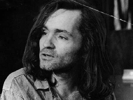 Charles Manson meets the press during a break in his trial in 1969.