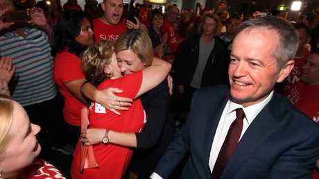 A jubilant Susan Lamb (left), the MP for Longman, and Labor leader Bill Shorten celebrating in Caboolture. Picture: AAP Image/Dan Peled.