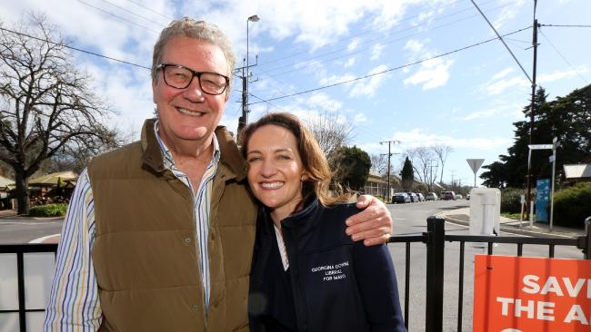 Liberal candidate Georgina Downer with her father, Alexander at a Mayo by-election pre-polling booth in Mount Barker. AAP Image/Kelly Barnes.