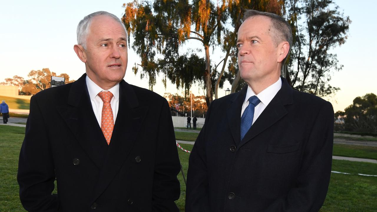 Australian Prime Minister Malcolm Turnbull (left) speaks to Australian Opposition Leader Bill Shorten. Picture: Lukas Coch/AAP