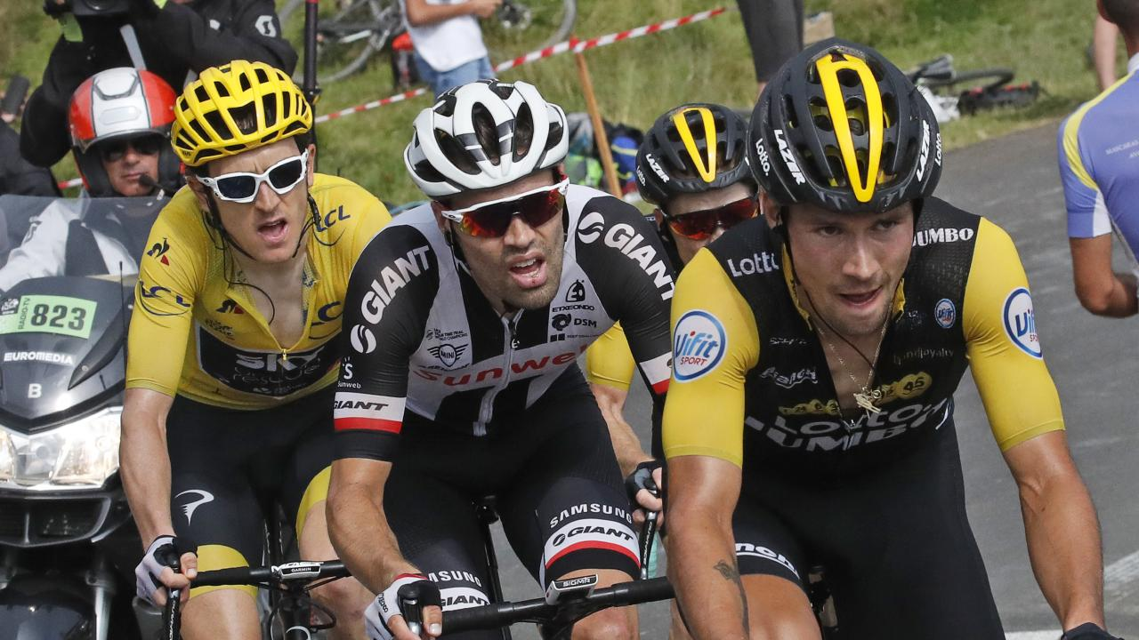 Stage winner Primoz Roglic followed by Tom Dumoulin, left, and Geraint Thomas, wearing the overall leader's yellow jersey, climb Col d'Aubisque. Picture: Christophe Ena/AP