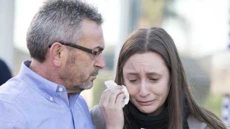 Sarah Ristevski wipes away tears as she's comforted by her father, Borce. Picture: Sarah Matray