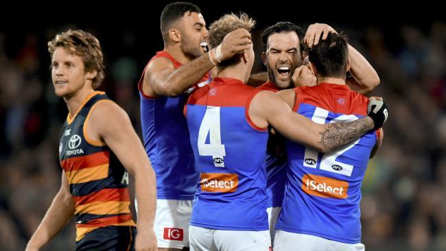 Melbourne players celebrate a Jordan Lewis goal.