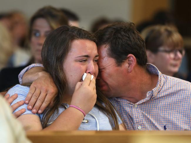 Roy's father and sister mourn in court. Picture: Pat Greenhouse/The Boston Globe via Getty Images