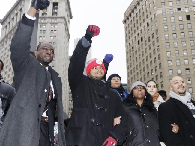 The Central Park Five were imprisoned, then sensationally exonerated after a serial rapist confessed to the crime more than a decade later. From left, Yusef Salaam, Kevin Richardson, and Raymond Santana react to supporters in New York. Picture: AP Photo/Frank Franklin II, File