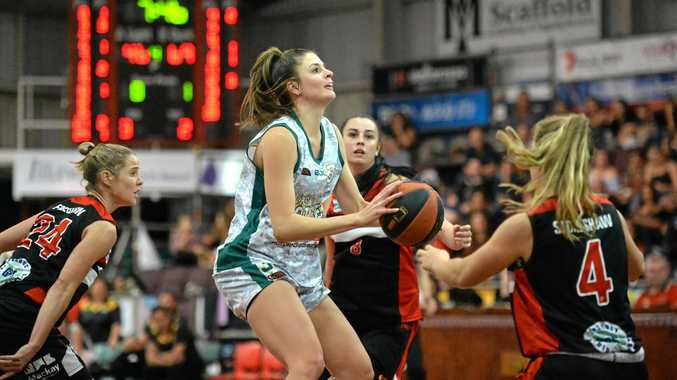 Ipswich Force centre Meg Essex lines up the basket in Friday night's 88-63 state league win over Mackay.
