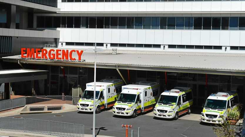 Rockhampton four ambulances parked outside the Emergency Department at the Rockhampton Hospital.