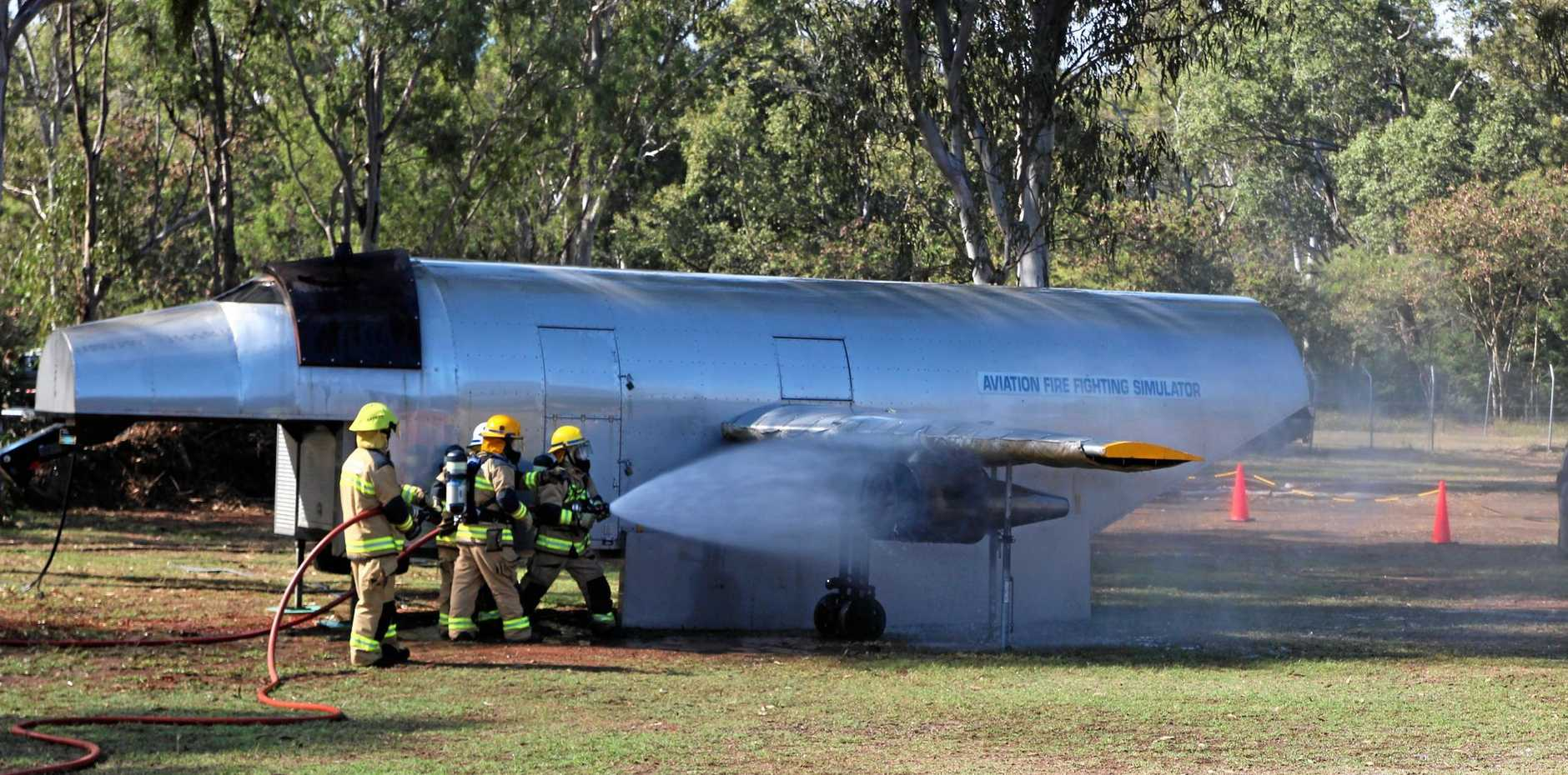 Rural Fire Service crews show off their skills in a simulated plane crash where the engine caught fire.