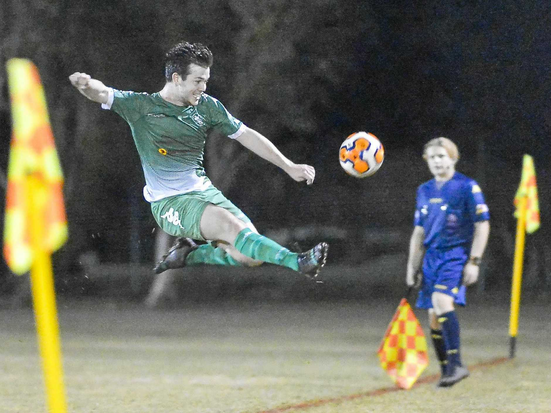 Clinton's Ethan Munster works hard to keep the ball in against Frenchville.