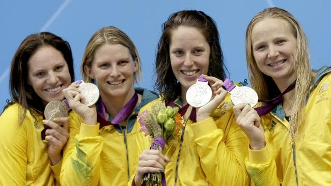 Emily Seebohm and Leisel Jones celebrate winning silver together in London. Picture: AP